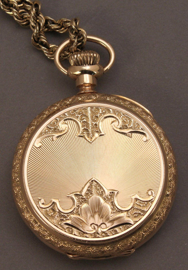 Lot 176: 14K Elgin lady's pendant watch w/ 14K gold chain