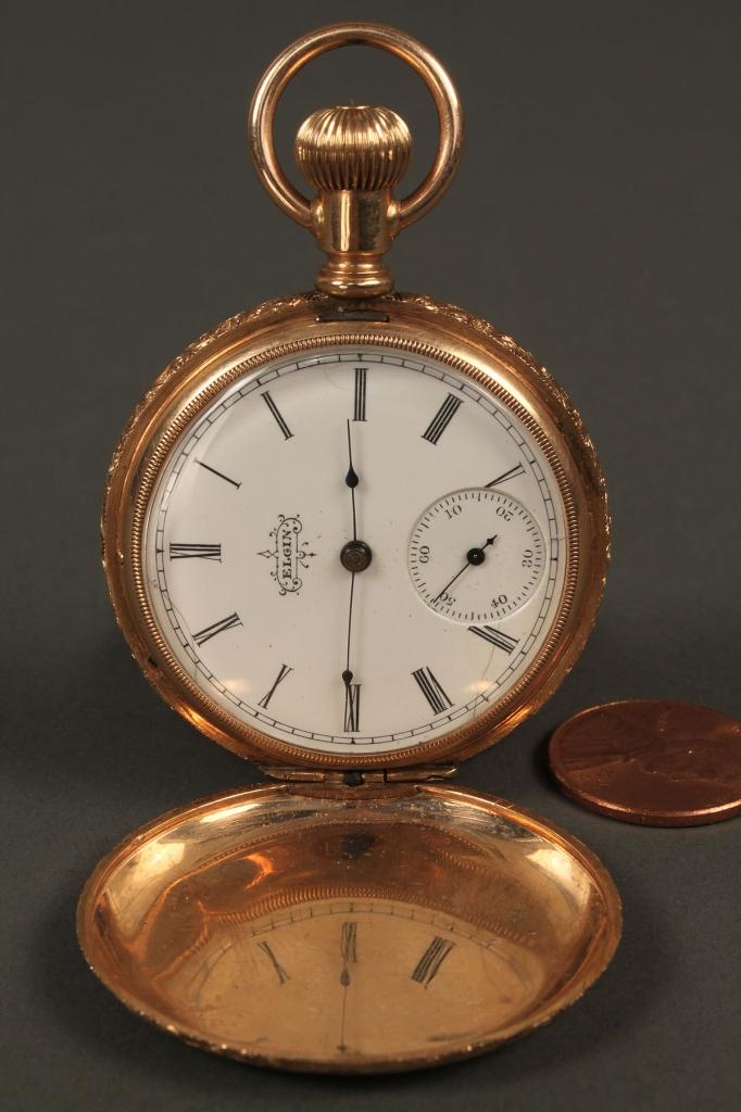 Lot 177: 14K Elgin pocket watch with star pattern