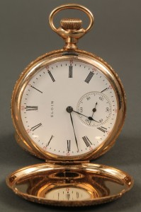Lot 178: 14K gold Elgin pocket watch with c-scroll filligre