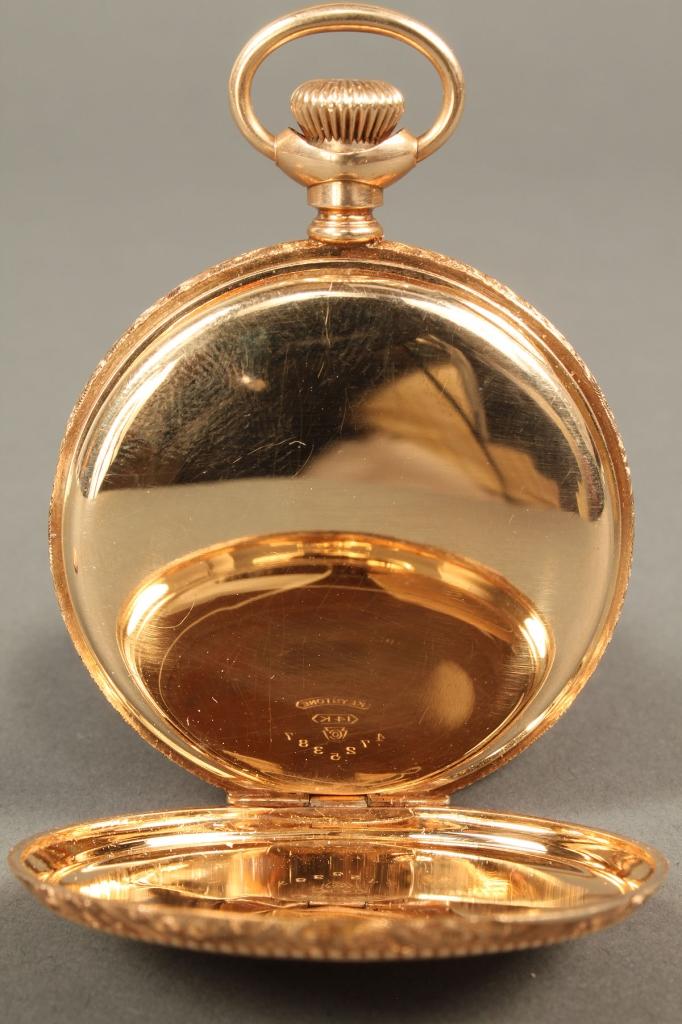 Lot 178: 14K gold Elgin pocket watch with c-scroll filligre