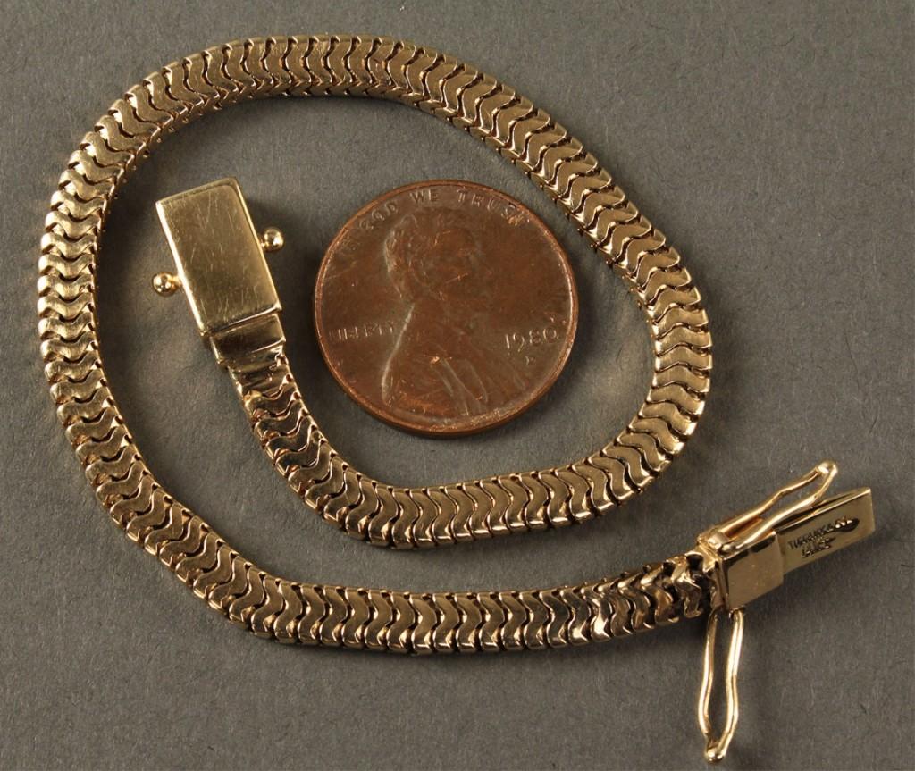 Lot 179: Tiffany 14K serpentine bracelet