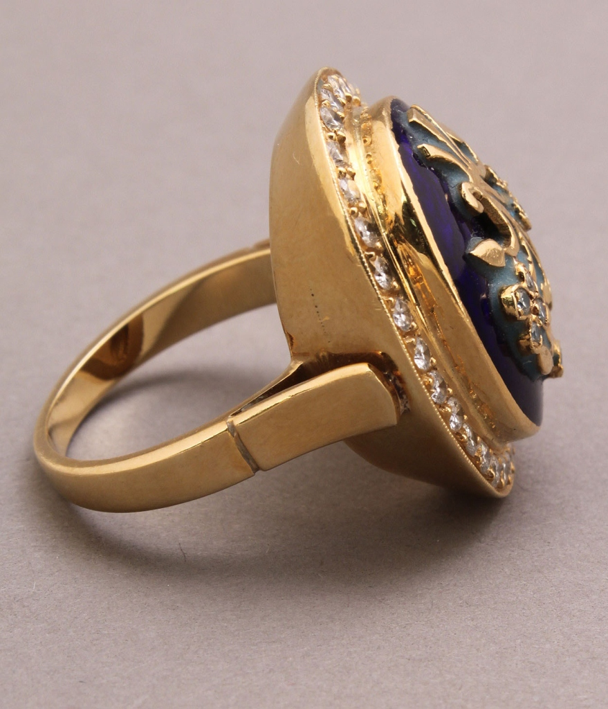 Lot 182: 18K diamond and enamel floral crest ring