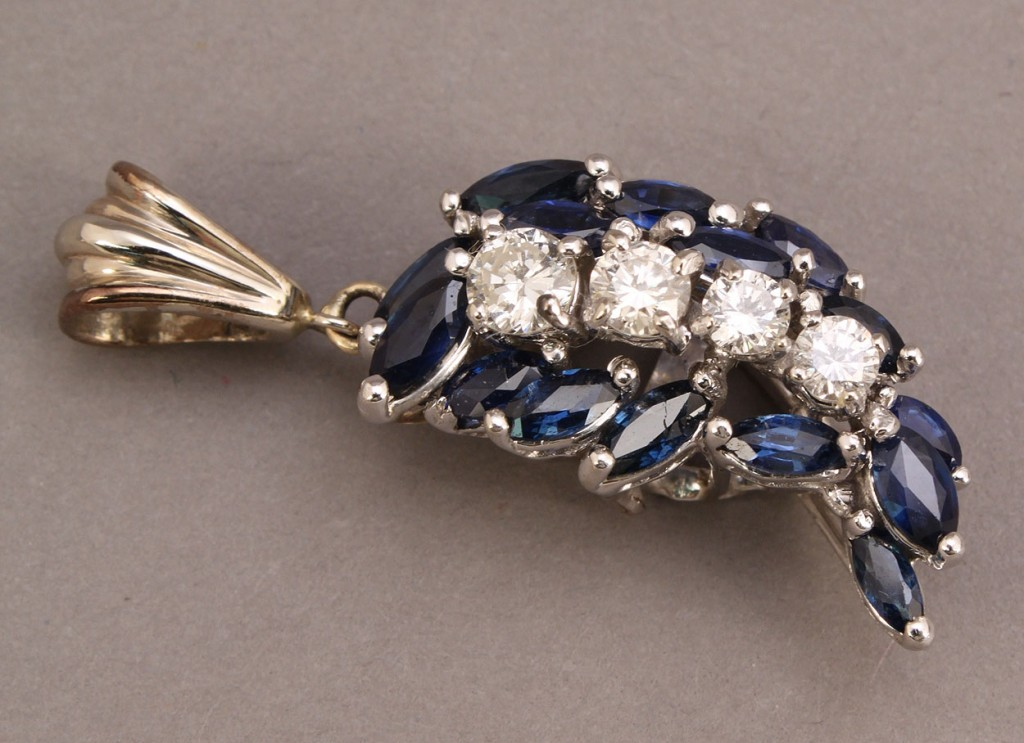 Lot 183: 14K sapphire and diamond crescent pendant