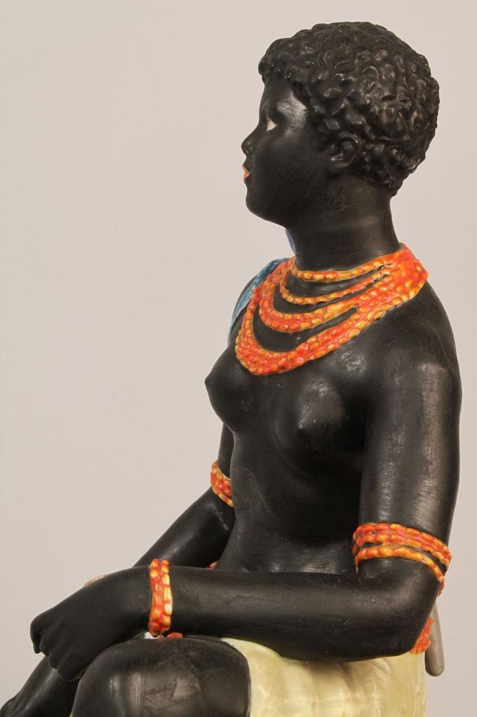 Lot 204: Blackamoor porcelain figure of African Hunter