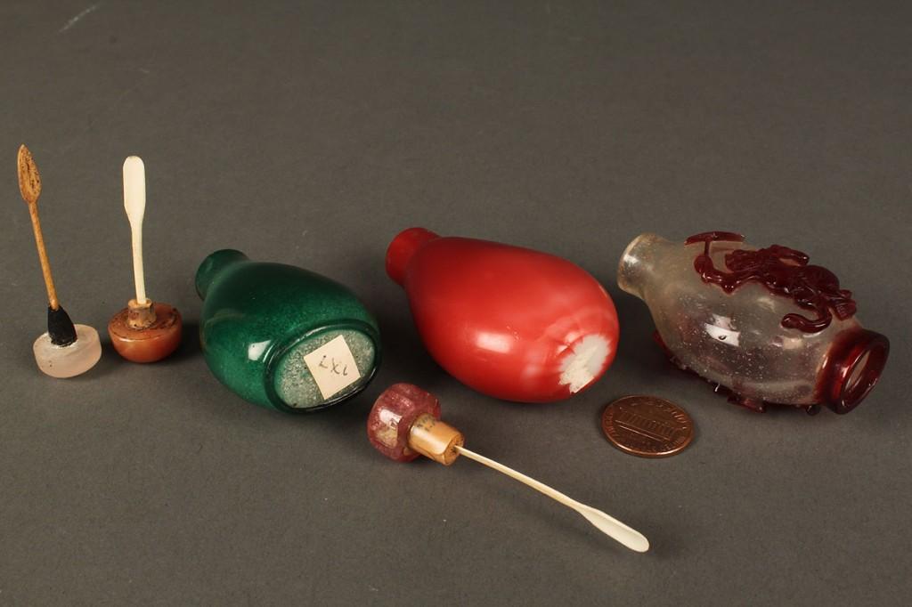 Lot 234: Three Peking glass snuff bottles