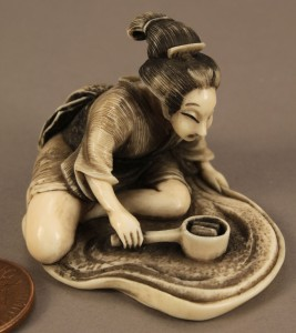 Lot 238: Ivory okimono style figural netsuke, signed