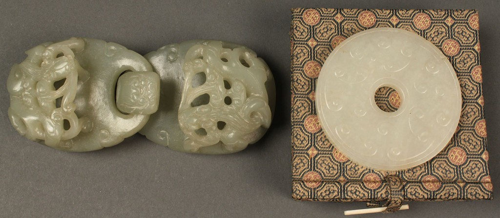 Lot 239: Chinese carved jade buckle and white jade bi disc