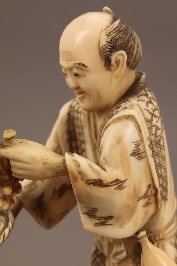 Lot 245: Ivory Okimono figure, Fruit and Vegetable Seller