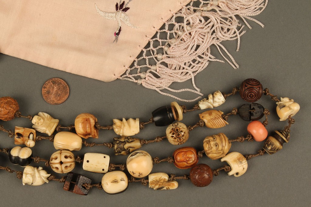 Lot 246: Collection of 52 Asian Ojime beads w/ Silk Pouch