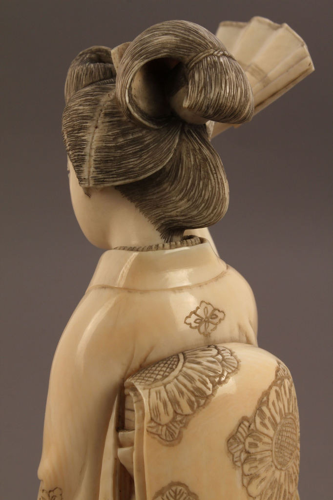 Lot 248: Ivory Okimono figure of a Geisha
