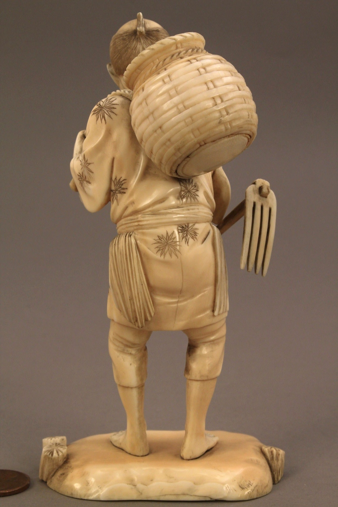 Lot 250: Asian Ivory Okimono figure, farmer with basket