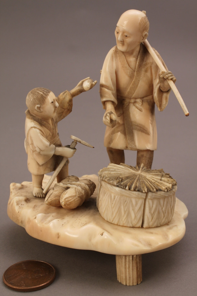 Lot 251: Ivory Okimono figure, man and boy working in the f