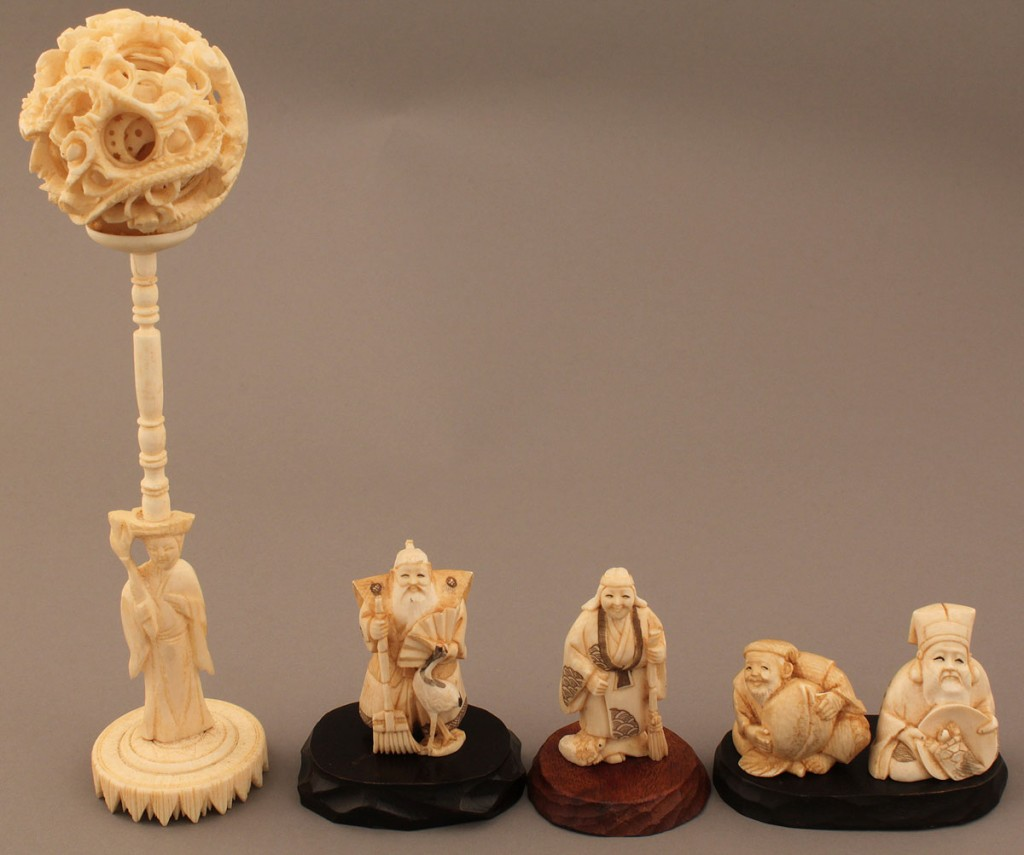 Lot 252: Asian Ivory puzzle ball & figures, 5 items