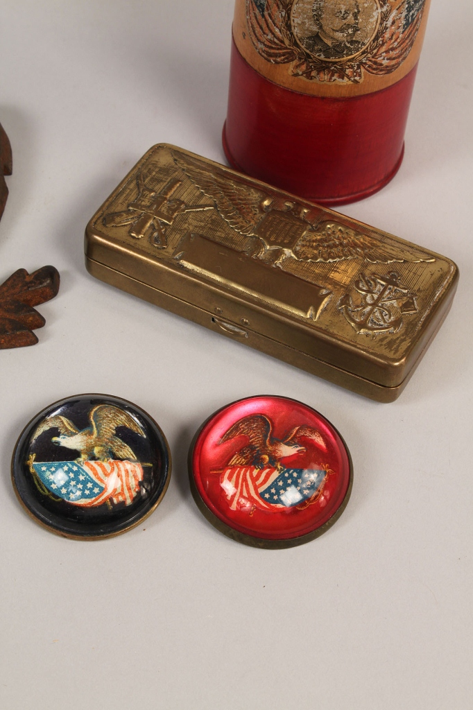 Lot 267: Six patriotic items: iron eagles, pins, bank, and