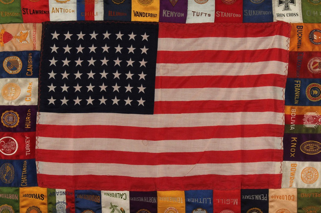 Lot 271: Framed 48 star flag with college pennants