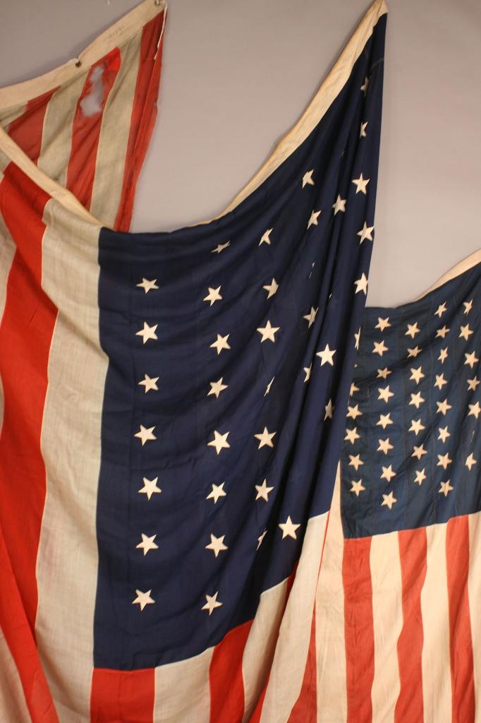 Lot 276: Three 45 star flags, Horstmann & prob. Naval