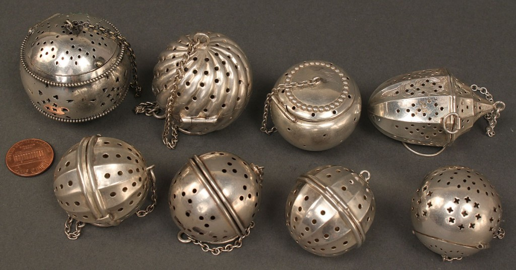 Lot 380: Lot of 8 tea infusers, 5 sterling incl. urn, 4 bal