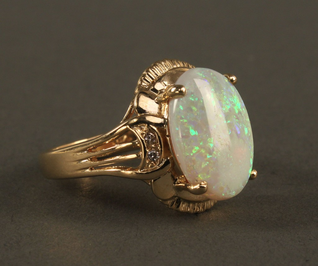 Lot 383: 14K Opal and Diamond Ring