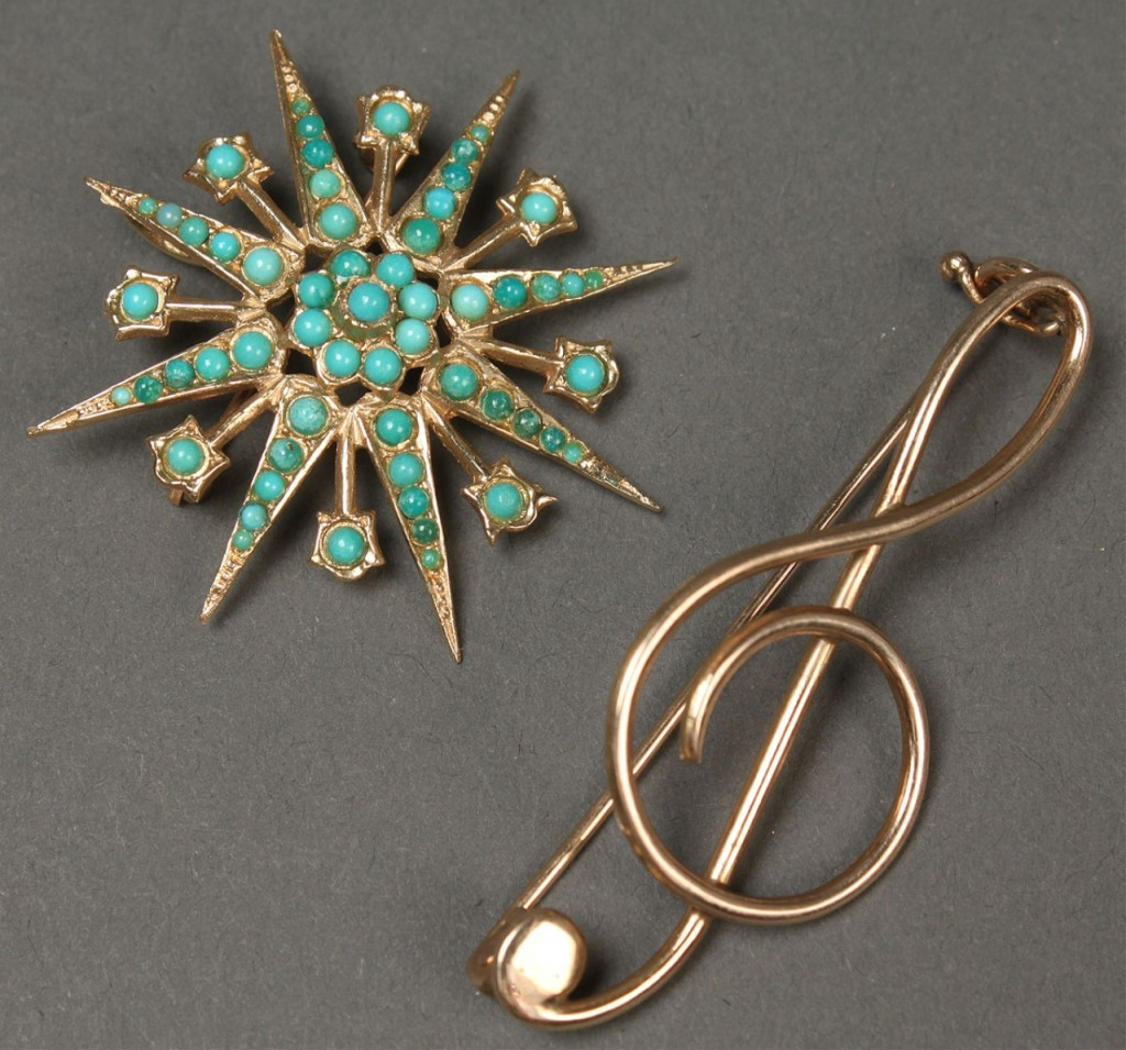 Lot 386: Two 14K pins, Turquoise starburst & Treble staff