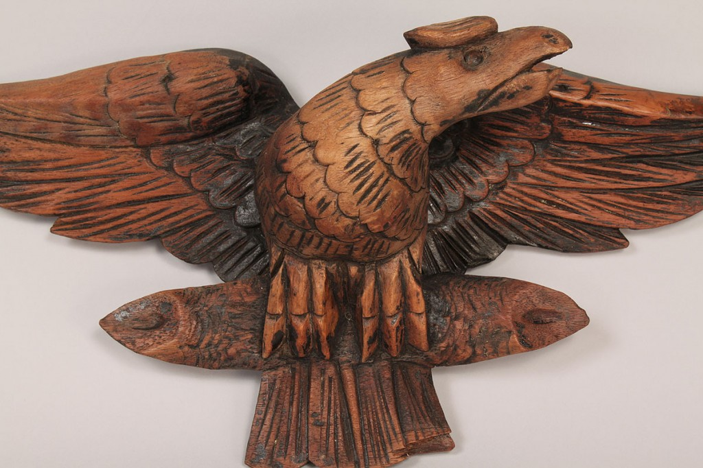 Lot 423: Wooden folk art carved eagle clasping a log
