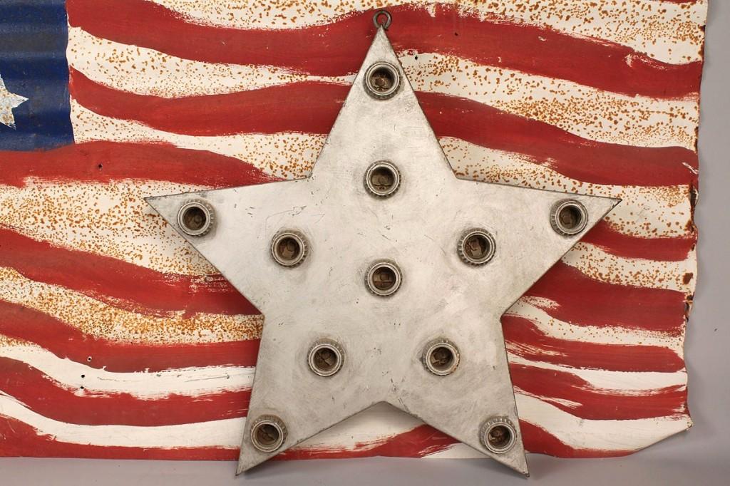 Lot 438: 2 metal sculptures, tin flag & star shaped light f