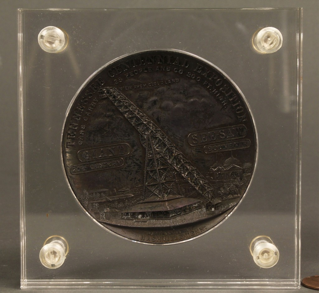 Lot 453: 2 TN Centennial Items: book and See Saw medal