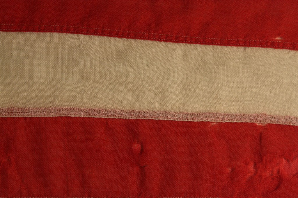 Lot 481: 34 star wool flag with inscription, post Civil War