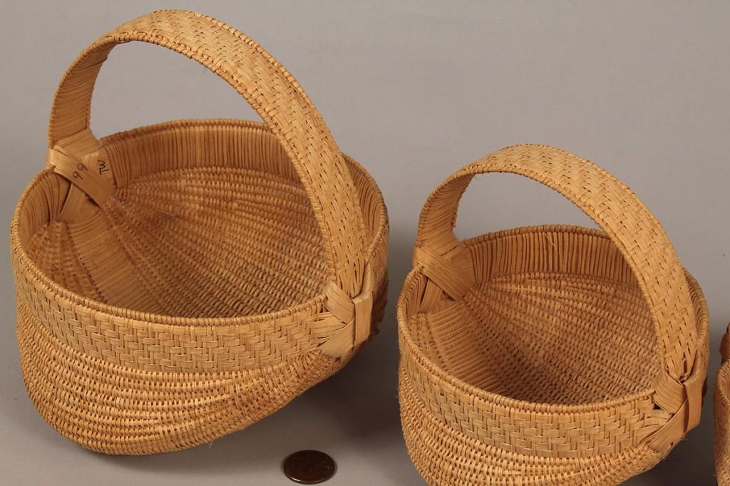 Lot 50: Set of 7 Miniature Graduated Baskets, Trevle Wood