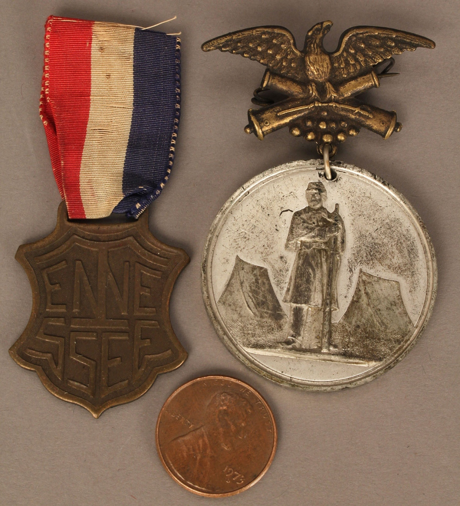 Lot 512: USS Tennessee and Nashville Tournament medals (2 i
