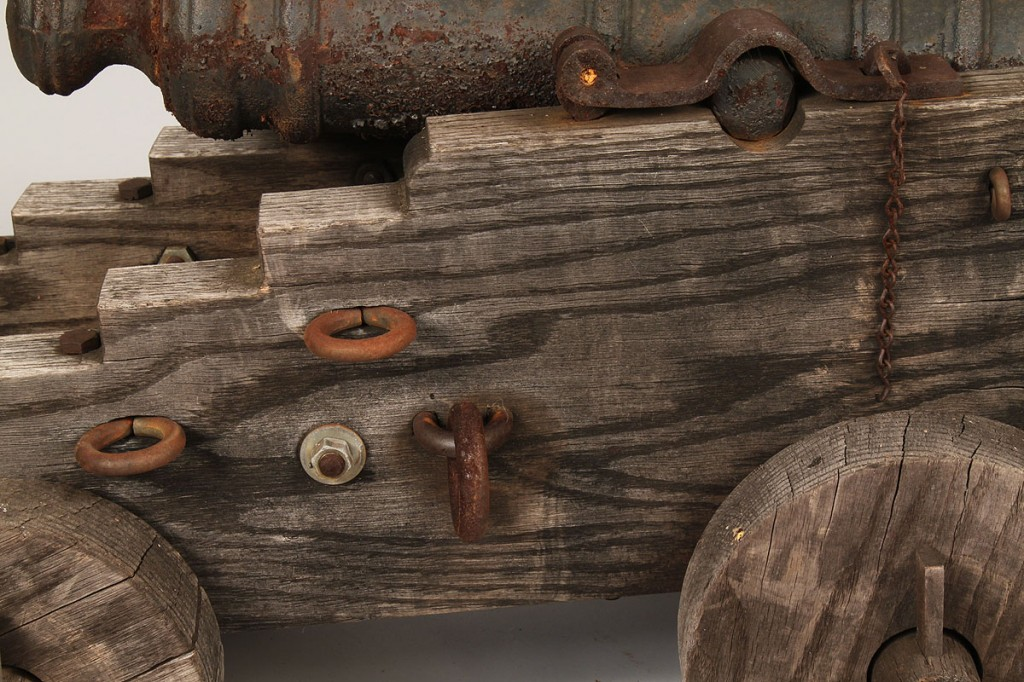 Lot 519: Small Iron cannon with oak carriage