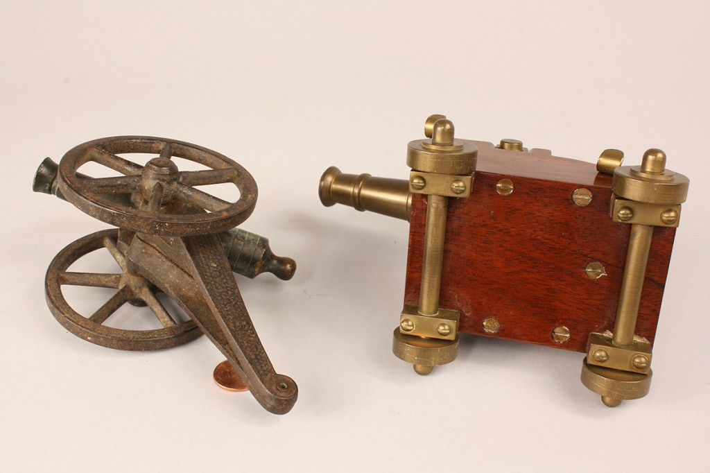 Lot 520: Four miniature firing cannons
