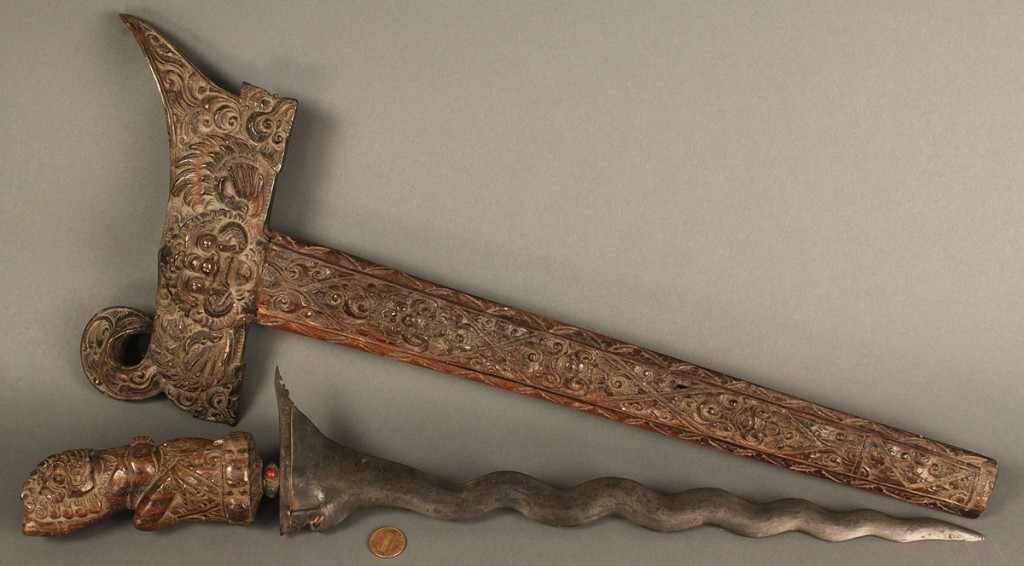 Lot 523: Elaborately carved Moro dagger or kris