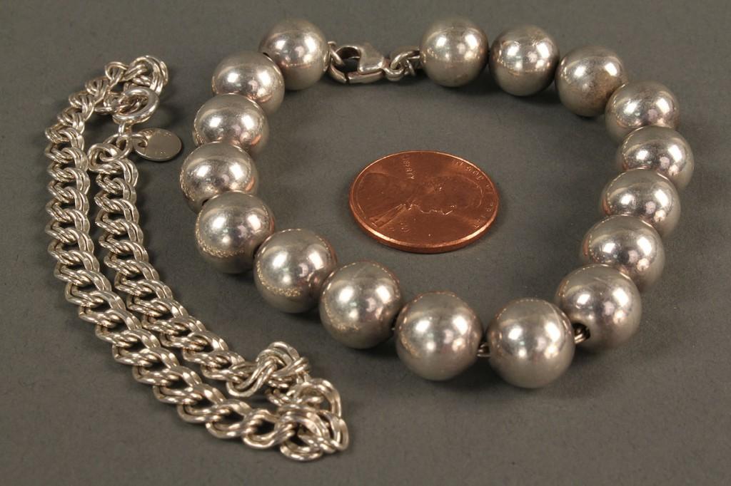 Lot 557: 2 Tiffany Sterling Bracelets, Bead & Link