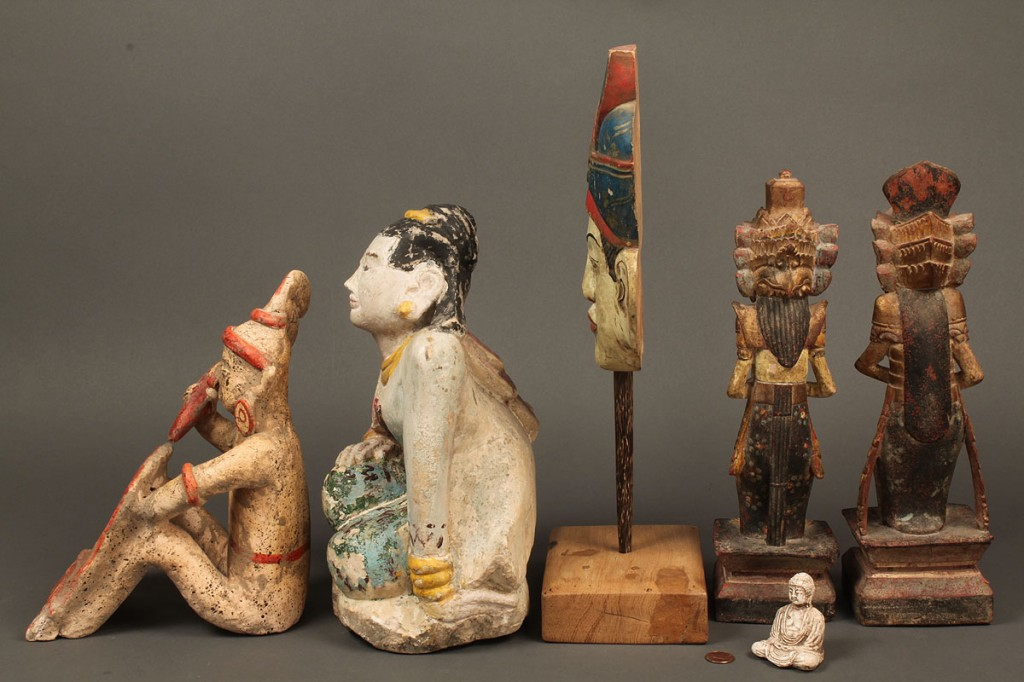 Lot 603: Six Asian or Oriental carvings and sculptures