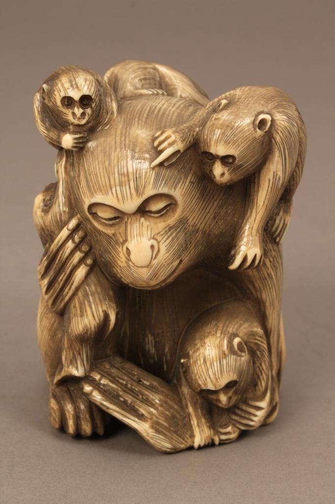 Lot 609: Large carved bone or ivory monkey netsuke
