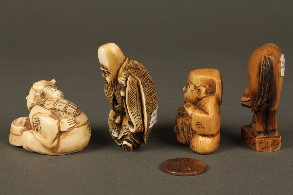 Lot 610: Four assorted carved ivory netsukes