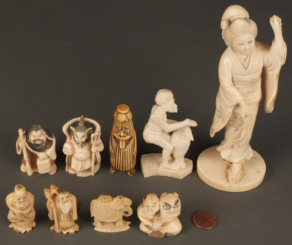 Lot 611: Group of 9 carved ivory items including netsukes