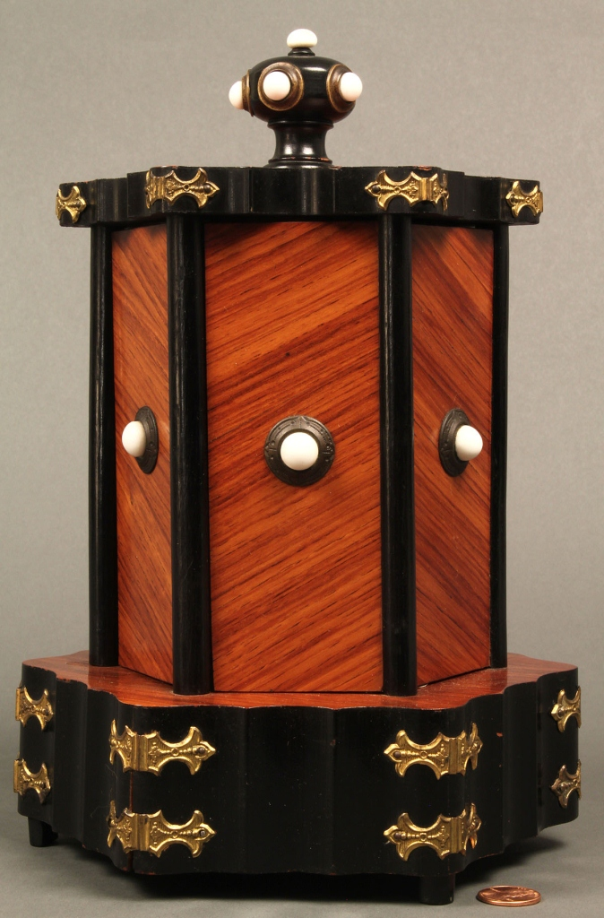 Lot 657: Rare pivoting kingwood sewing cabinet, tabletop