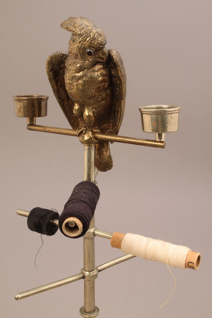 Lot 659: Sewing and candle caddy with figural parrot finial