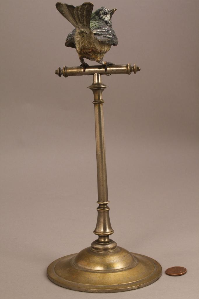 Lot 660: Figural brass sewing bird stand