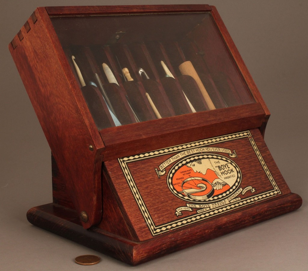 Lot 666: Boye Needle Co. Countertop Display Case & contents