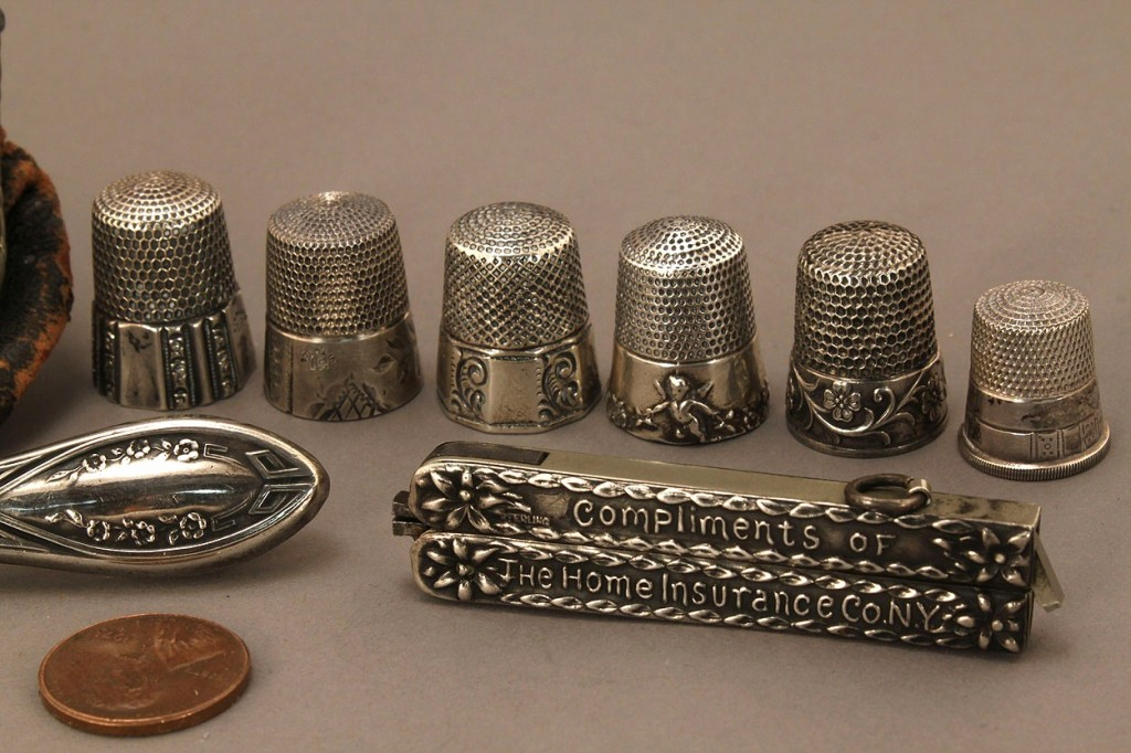 Lot 668: Collection of silver sewing implements, 16 pcs
