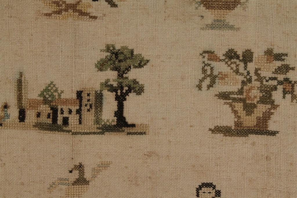 Lot 673: Needlework House Sampler