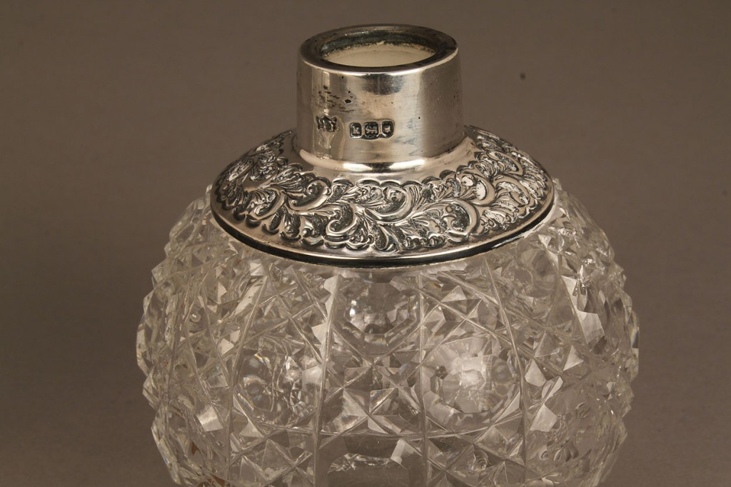Lot 690: Three silver and glass perfume bottles