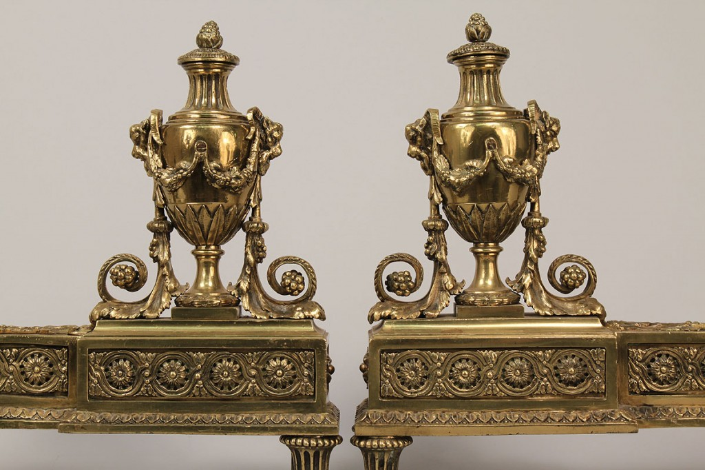 Lot 697: Pair of gilded fireplace chenets