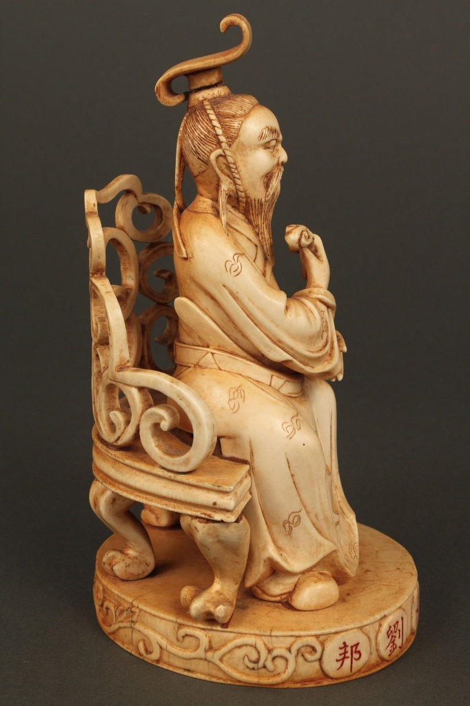 Lot 6: Chinese Carved Ivory Figure of Scholar or Emperor