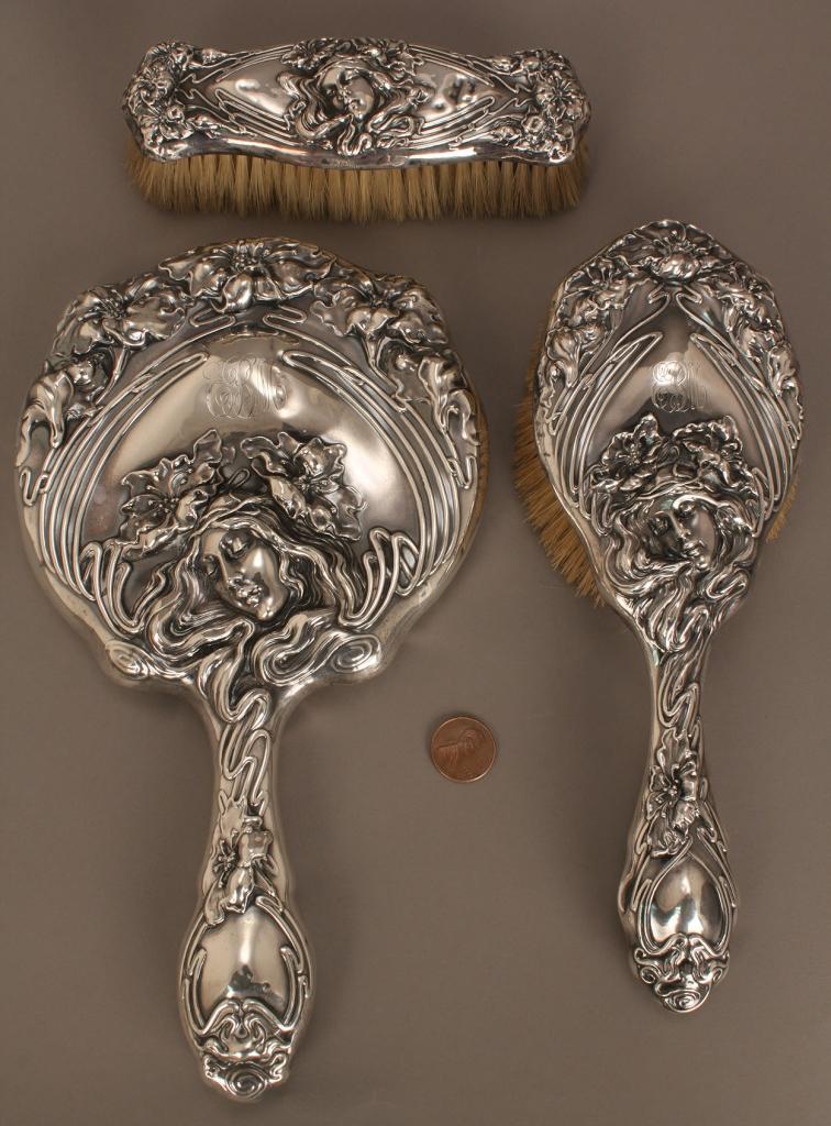 Lot 719: 3-piece sterling Art Nouveau dresser set