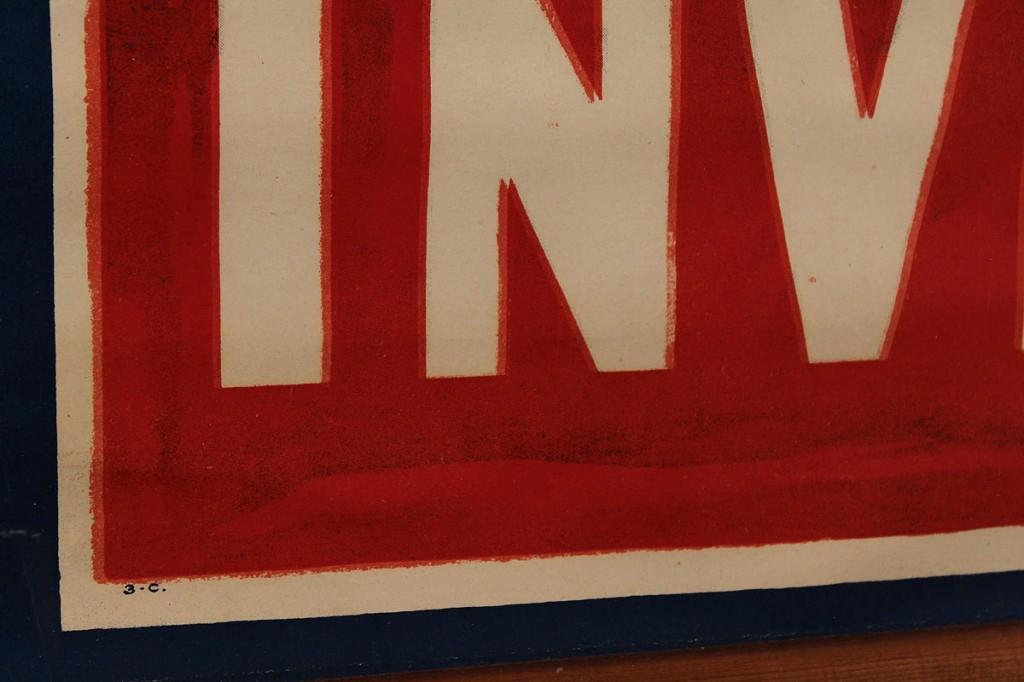 "Lot 730: WWI banner, ""Invest"", plexiglass case"