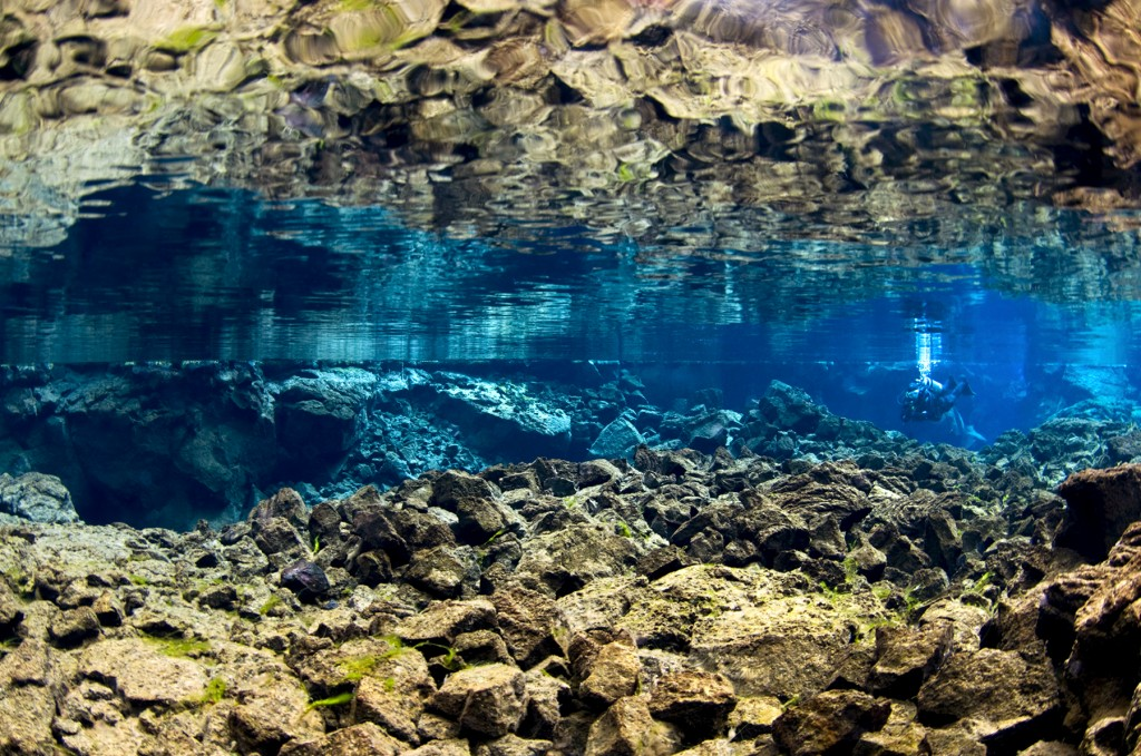 Silfra_surface_mirror_shallows_diver-1024x679
