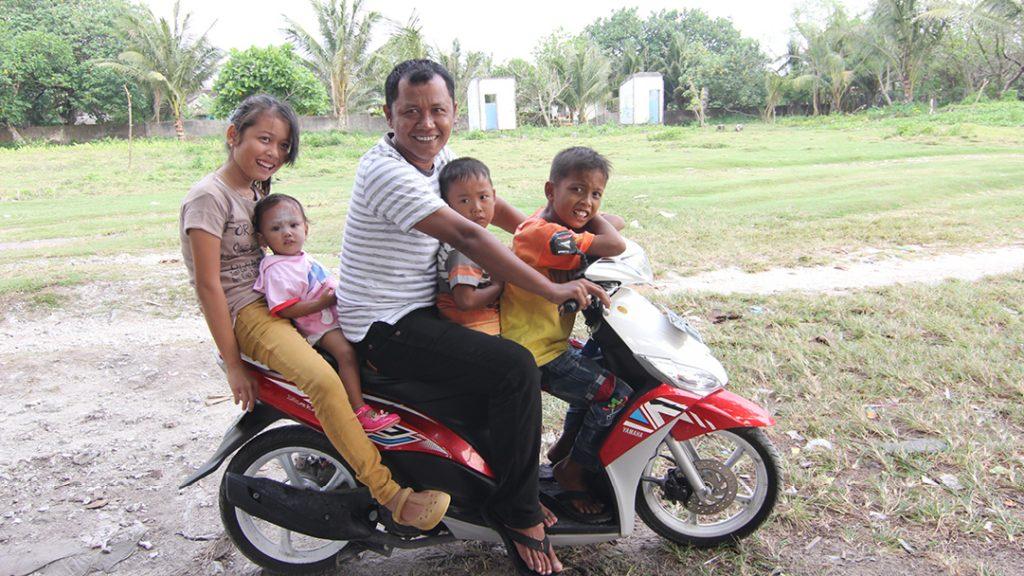 A foto clássica: família na moto. Foto: Carla Lima Rocha